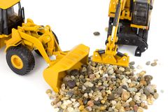 Machinery and pebbles Stock Photo