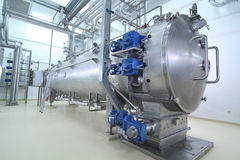Machinery in a pharmaceutical production plant. Modern machinery in a pharmaceutical production plant Royalty Free Stock Photos
