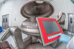 Machinery production cutting large quantities of meat Stock Images