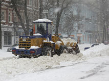 Machinery snowblower. Natural disasters winter, blizzard, heavy snow paralyzed the city, collapse. Snow covered the cyclone Europe Royalty Free Stock Photography
