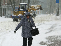 Machinery snowblower. Natural disasters winter, blizzard, heavy snow paralyzed the city, collapse. Snow covered the cyclone Europe Stock Photos