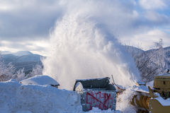 Machinery with snowplough blowing the heavy snow Stock Image