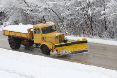 Machinery with snowplough cleaning road Stock Image