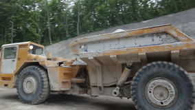 Machinery Takes Extracted Limestone out of Mine stock video footage