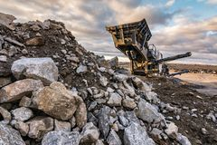 Machinery to transform the stone into gravel to build roads. Machinery to transform the stone .into gravel to build roads royalty free stock photography