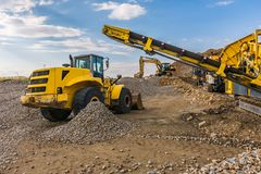Machinery varied in a quarry for the processing of the stone and its transformation into gravel stock photo