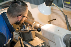 Machinery worker at lathe machine in workshop Royalty Free Stock Image