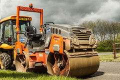 Machinery for working roads (under construction). Stock Photography