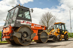 Roller and Digger for road construction. Stock Images