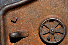 MachineryWheel. Close-up of a wheel on a machine door royalty free stock image
