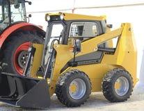 Machines agricoles, chargeur avant à l'exposition Images libres de droits