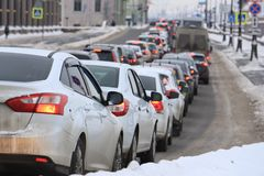 Machines in a city traffic jam. Cars in a traffic jam in a winter city Royalty Free Stock Photos
