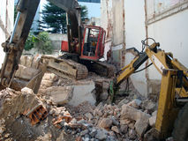 Machines of destroy. A Two machines in an urban demolish housing estate, montevideo, Uruguay, South America stock photos