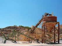 Gravel pit. Machines of a gravel pit and the destruction of a mountain stock images