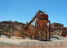 Gravel quarry. Machines of a gravel pit and the destruction of a mountain stock photography