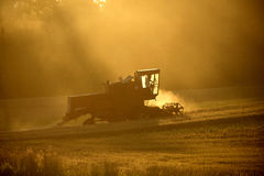 Machines for harvesting in from the sun. Machines for harvesting in from the evening sun Stock Photography