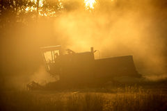 Machines for harvesting in from the sun. Machines for harvesting in from the morning sun Stock Photos