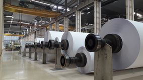 Machines for the production of paper rolls and roll of white paper stock photo