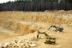 Machines in quarry Royalty Free Stock Photo