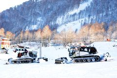 Snow removal machines are moving on the mountain stock image