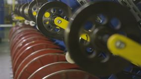 Machines Wind Threads for Tire Reinforcement Closeup. Closeup heavy industry machines wind threads for tire reinforcement in powerful enterprise stock video footage