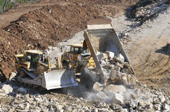 Machines work on public works. Construction of the expressway IC9 Leiria - Portugal Stock Image