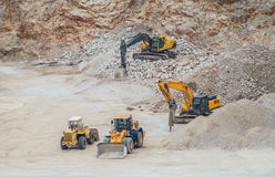 Machines working at gravel pit Royalty Free Stock Photography