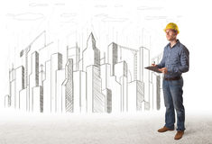 Machinez l'homme avec le dessin de ville de bâtiment à l'arrière-plan Photo libre de droits