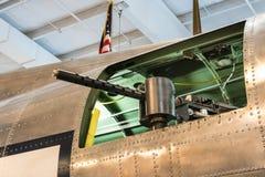 Maching Gun Mounted Out the Window of a Warplane. Side mounted machine gun on a viintage warplane.  Gun pointed out the side window Stock Images