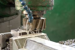 Machining. Metal part in factory Royalty Free Stock Image