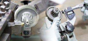 Machining automotive part by cnc turning machine. Operator machining automotive part by cnc turning machine royalty free stock photography
