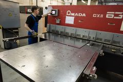 Machining by cutting large steel sheets on an automated computer stock image