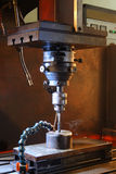 Machining metal. Machining tool in action, spinning in hi-rev stock images