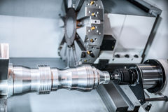 Machining of parts on a lathe. Royalty Free Stock Image