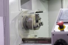 The machining safety guard. And emergency stop button for lathe machine ; prevent accident royalty free stock photo