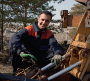 Machinist excavator with a wrench in his hand Stock Image