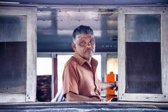 The machinist at Kandy`s train station, Sri lanka Royalty Free Stock Image