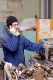 Machinist on phone Royalty Free Stock Images