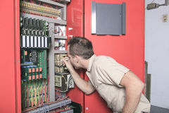 Machinist worker technicians at work adjusting Royalty Free Stock Photos