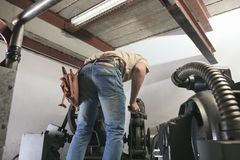 Machinist worker technicians at work adjusting Royalty Free Stock Image