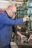 Machinist working on machine Stock Photography