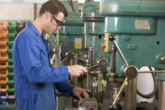Machinist working on machine Royalty Free Stock Photography