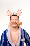 Machismo. Tough young man playing machismo with horns over head royalty free stock image