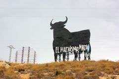 `Machismo kills` writing on a big shield shaped like a bull in Spain stock photo