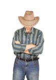 Machista con un cigarrillo en un sombrero de vaquero Foto de archivo