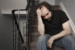 Macho adulto deprimido foto de stock