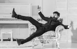 Macho attractive and elegant on cheerful face and surprised expression. Fashion and style concept. Man with beard and. Mustache wearing fashionable classic suit stock images