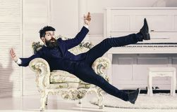 Macho attractive and elegant on cheerful face and surprised expression. Fashion and style concept. Man with beard and. Mustache wearing fashionable classic suit stock photography