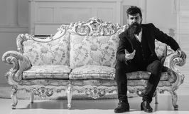 Macho attractive and elegant on serious face and thoughtful expression. Fashion and style concept. Man with beard and. Mustache wearing fashionable classic suit royalty free stock photography