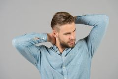 Macho in blue fashionable shirt, fashion. Man with bearded face and blond hair, haircut. Mens fashion style and trend. Grooming an. D hair care in beauty salon royalty free stock photos